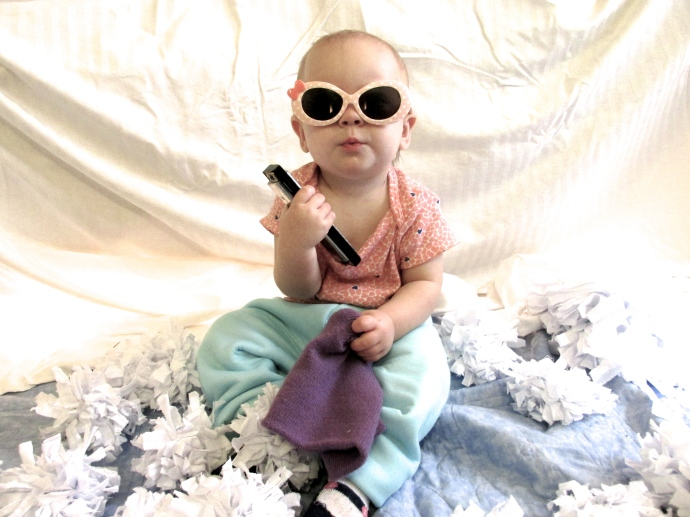little E at 11 months... owning that harmonica.