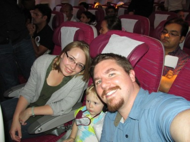 Our first international flight! Judah liked the headrest TVs.
